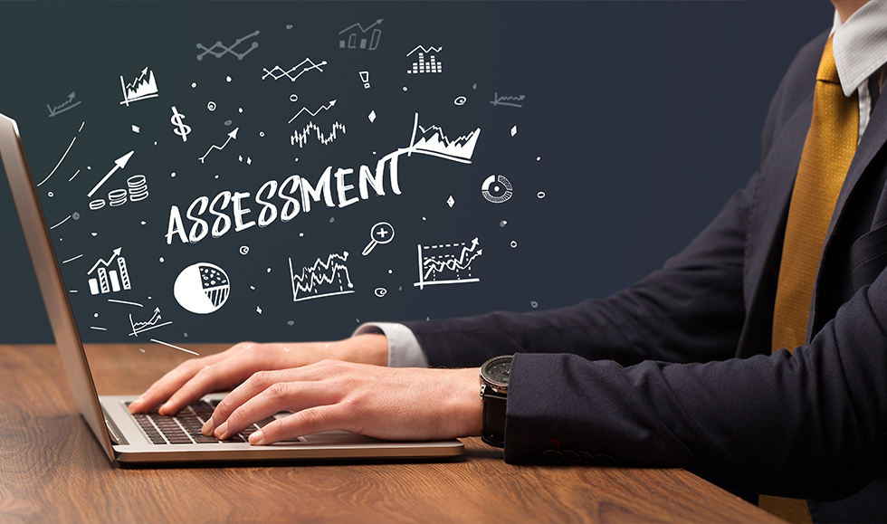 What is a skills assessment? Man typing, laptop, assessment